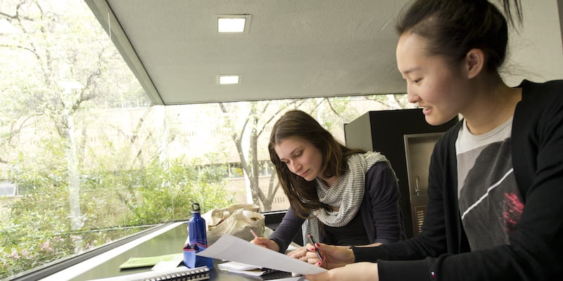 Two people looking over study materials