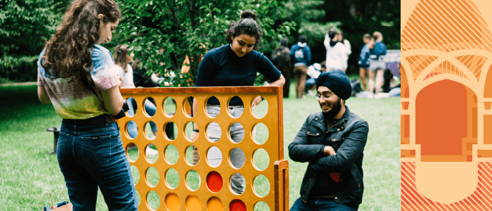 Students playing a giant board game on South Lawn