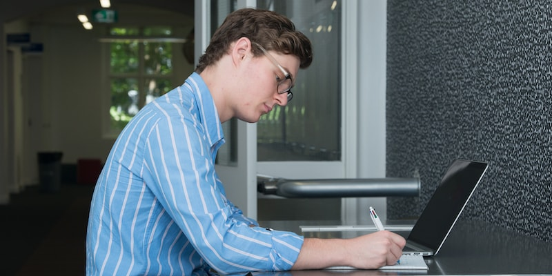 A student studying at a desk.