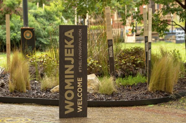 A shot of the outdoor gallery landscape, with a sign reading 'Wominjeka'