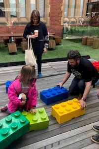 Students playing with giant lego bricks - Open Day 3