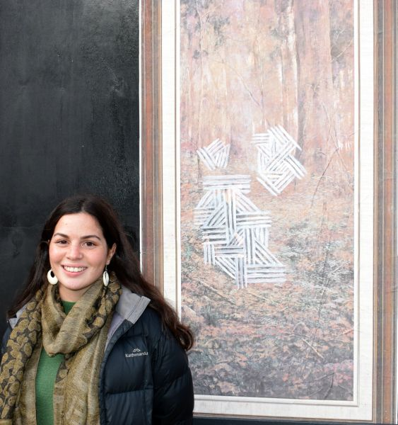 Moorina Bonini in front of 1 of 3 art panels entitled 'Found' (2018), on display at the Outdoor Gallery