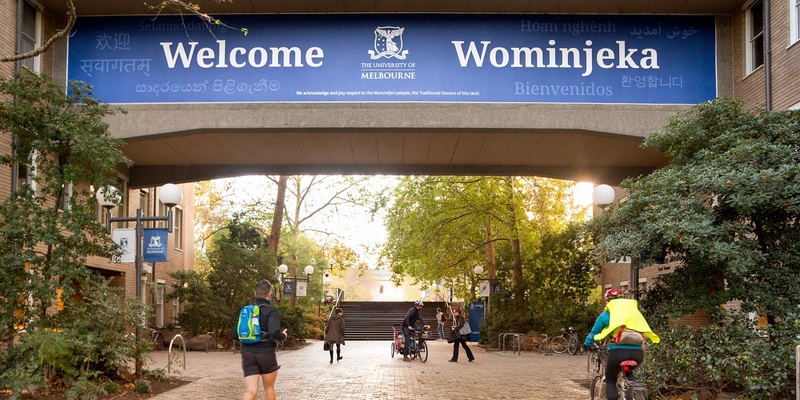 A sign above the entrance to the Parkville campus saying